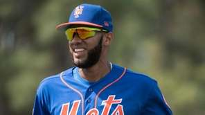New York Mets prospect Amed Rosario warms up