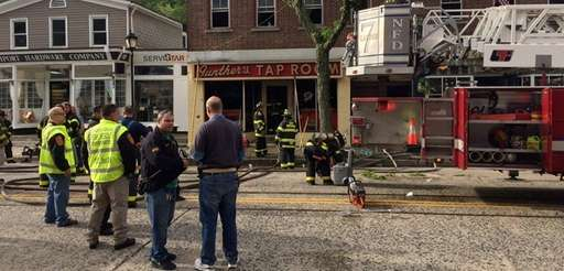 Firefighters outside Gunther's Tap Room in Northport after