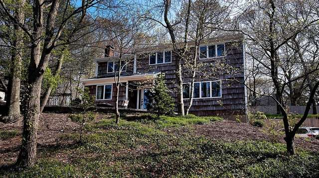 The four-bedroom house in Port Jefferson is listed