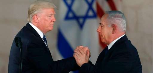 President Donald Trump shakes hands with Israel's Prime