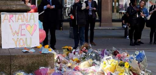 Floral tributes are seen in Manchester, England, Tuesday