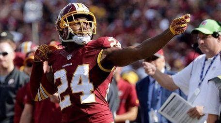 Washington Redskins cornerback Josh Norman celebrates his interception