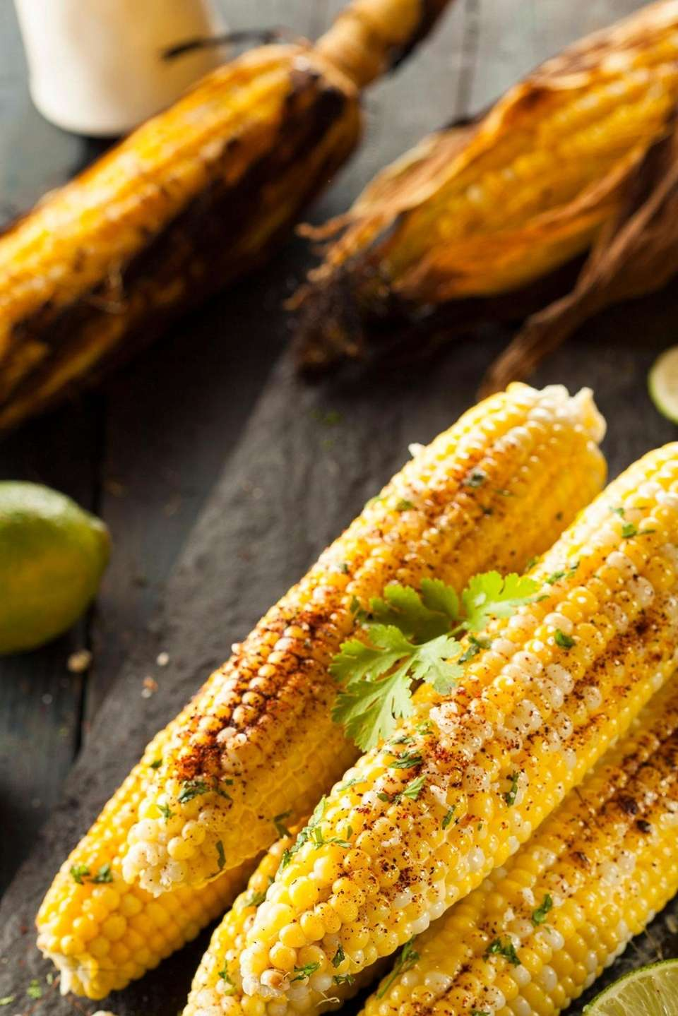 Stock photo of grilled mexican corn with chili,