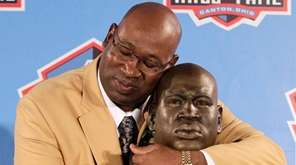 Former NFL player Cortez Kennedy poses with a