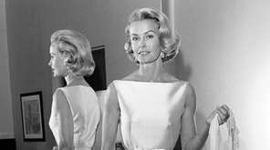 Socialite-actress Dina Merrill models the gown she will