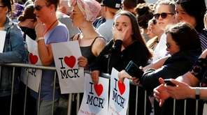 People attend a vigil in Albert Square, Manchester,