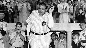 Babe Ruth, wearing his No. 3 uniform, receives