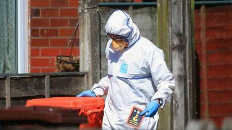 Police forensic investigators search the property of Salmon