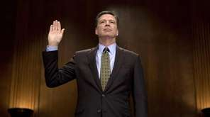 James Comey is sworn before his testimony before