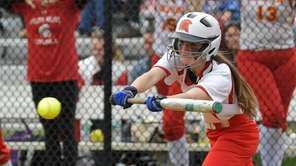 Sacred Heart's Emma Nidermaier (7) looks to bunt