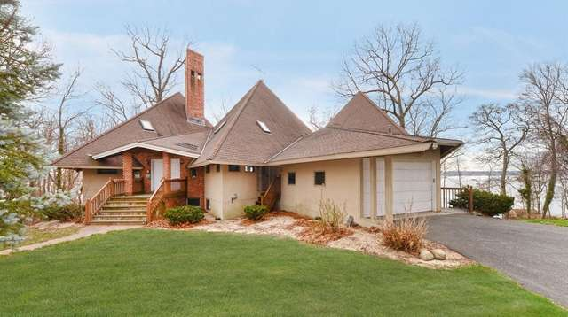 This four-bedroom Eatons Neck chalet-style home comes with