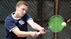 Smithtown West's Nick Gajda hits the backhand return