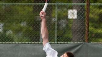 Roslyn's Daniel Weitz serves during the Nassau boys