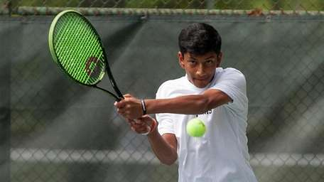 Syosset's Neel Rajesh hits the return during the