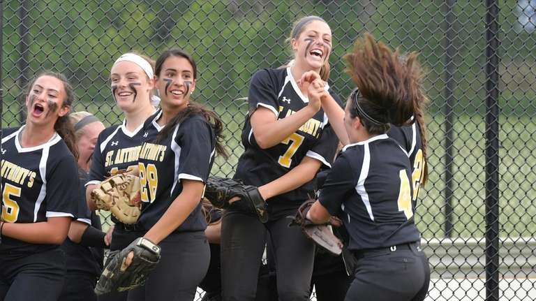 St. Anthony's players react to the 3 out