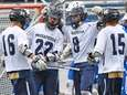 Brendan Nichtern of Massapequa is congratulated by teammates