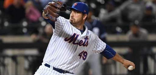 New York Mets relief pitcher Josh Smoker delivers