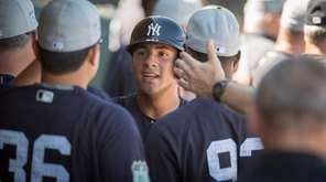 New York Yankees' Gleyber Torres is greeted with
