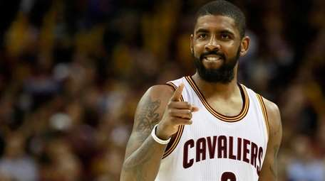 Kyrie Irving of the Cleveland Cavaliers celebrates late