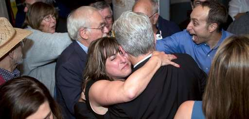 Democrat Christine Pellegrino is emotional as she hugs