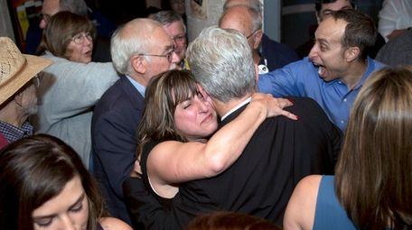 Democrat Christine Pellegrino is emotional as she hugs