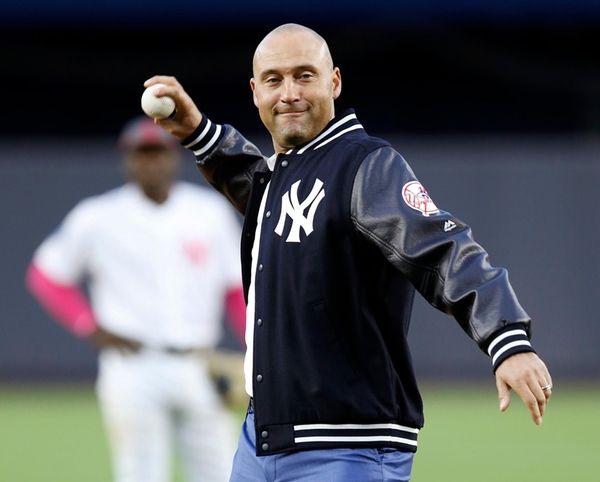 Retired New York Yankees shortstop Derek Jeter throws