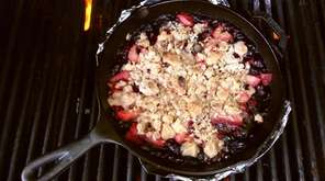 Place a berry crisp on the grill while