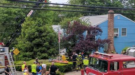 Emergency responders work to free a man from