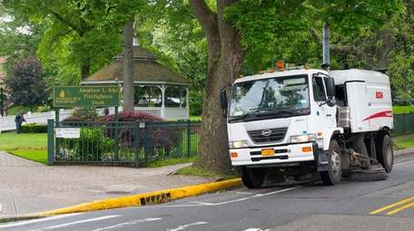A Village of Great Neck Plaza street sweeper
