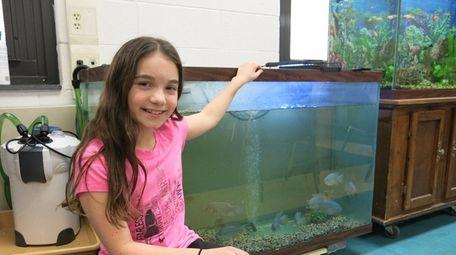 Kidsday reporter Alana Giallorenzi of Manorville is helping