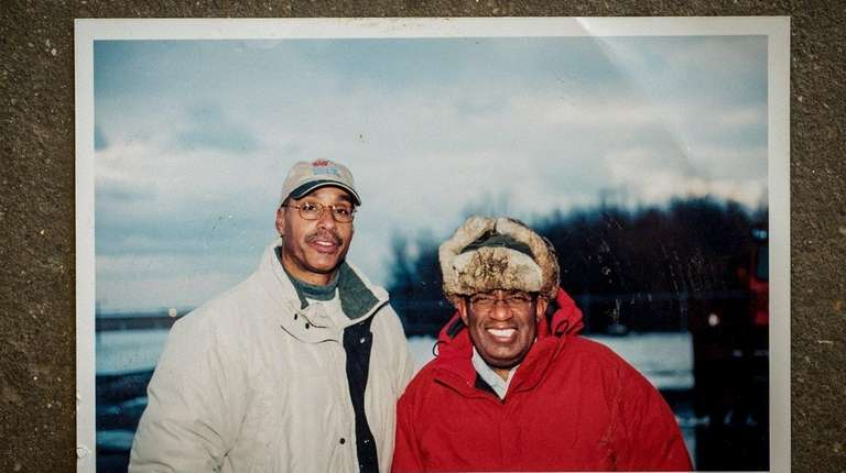 Robert Sinclair, left, with TV personality Al Roker
