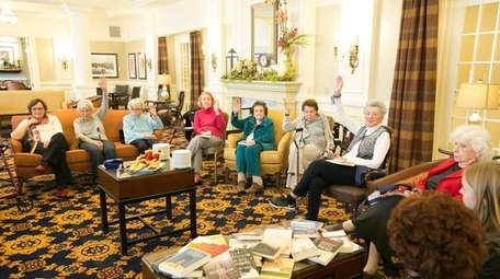 Residents participate in the book club led by