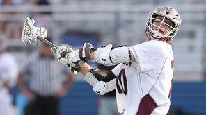Garden City's Kyle Steinbach (10) fires a shot