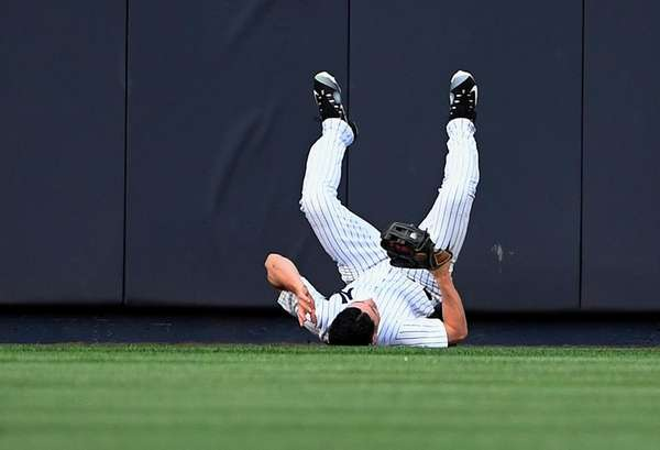 New York Yankees centerfielder Jacoby Ellsbury rolls to