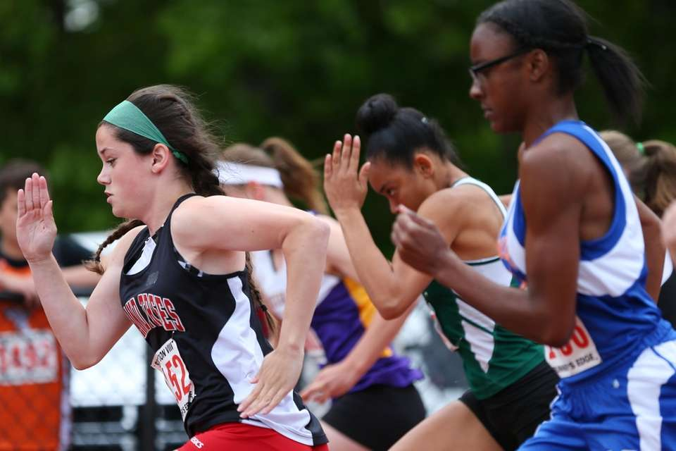Runners compete in the girls 100 meters during
