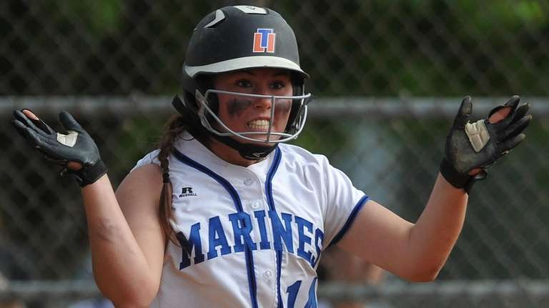 Tonianne Larson, Long Beach pitcher, reacts after crossing