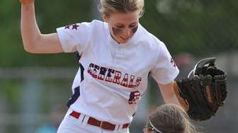 Jessica Budrewicz, MacArthur pitcher, left, celebrates with teammate