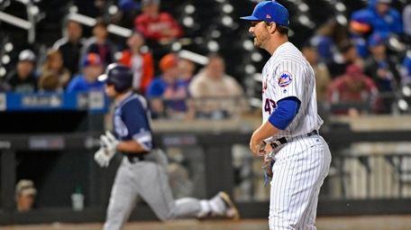 New York Mets relief pitcher Josh Smoker watches