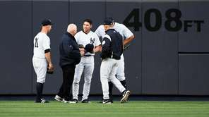 New York Yankees centerfielder Jacoby Ellsbury is checked