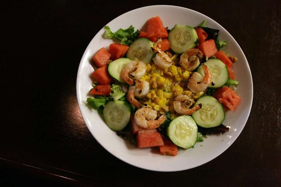 A plate of grilled shrimp watermelon salad is