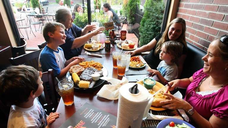 The Thornton family dines at Dixie's Smokehouse in