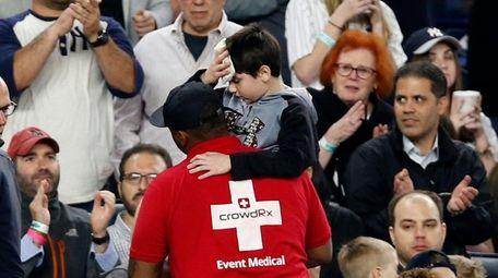 Fans applaud as a medical employee carries an