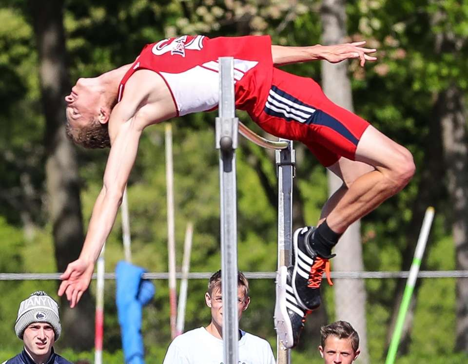 Daniel Claxton of Smithtown East clears 7'0