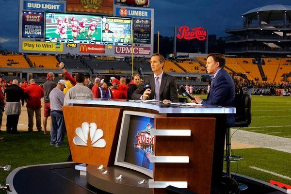 NBC Sunday Night Football announcers Chris Colliningsworth, center,