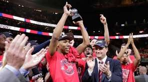 Arizona's Allonzo Trier holds up the trophy for