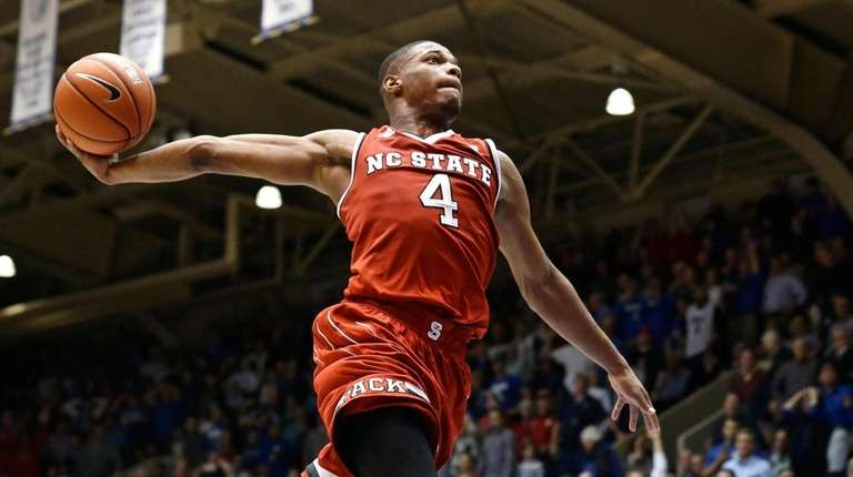 North Carolina State's Dennis Smith Jr.drives to the