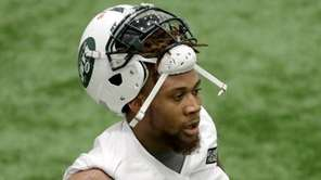 New York Jets' ArDarius Stewart looks on between