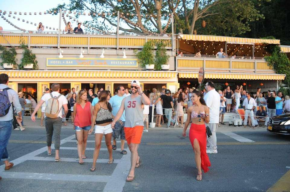 Goodbye peace and quiet. Hello, packed beaches, bars