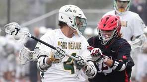Ward Melville's Zach Hobbes works against East's Brett