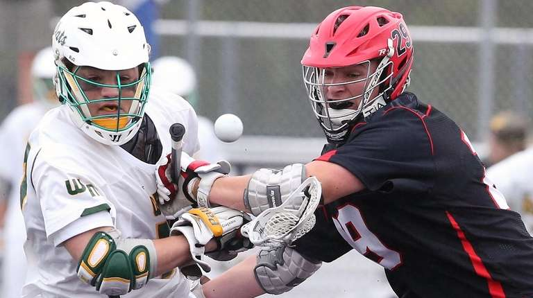 Ward Melville's Michael Giaquinto battles Hills East's Mike